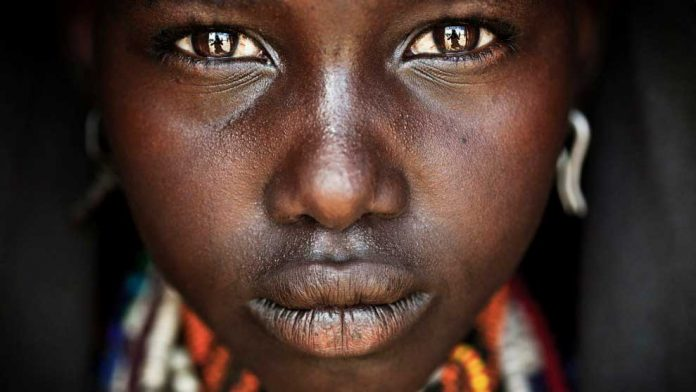 MATJAZ-KRIVIC,-SLOVENIA---WINNER,-TRAVEL-PORTFOLIO.-Omo-Valley,-Ethiopia-South-Ethiopia,-Arbore-village.-Onno,-a-teenage-girl-from-the-Arbore-tribe.-Canon-EOS-5D-MkII,-100mm-lens,-f2.8,-1_320s,-ISO-400