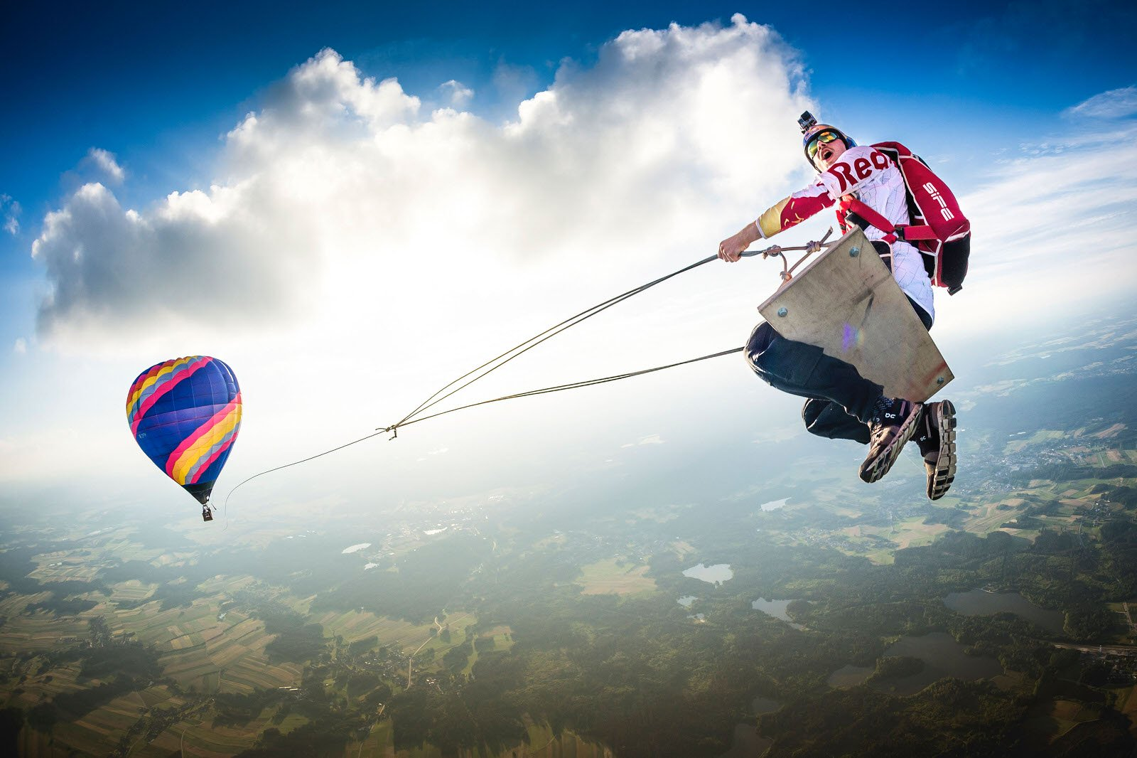 Wings: Philip Platzer, Austria, captures athlete Marco Fürst flying on an unthinkable hot air balloon swing in Fromberg, Austria.