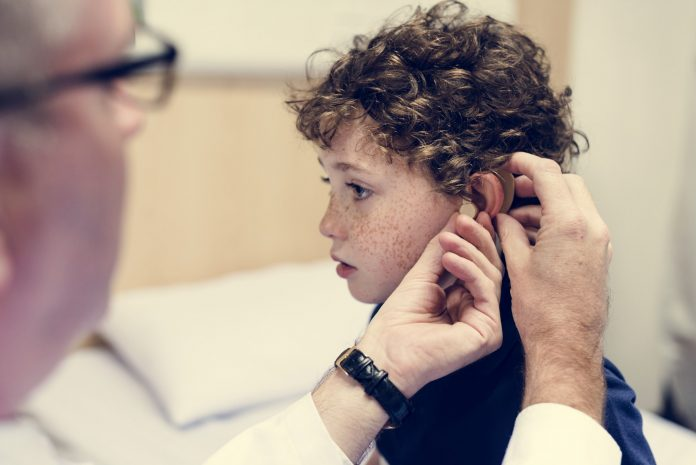Young boy having his ears checked